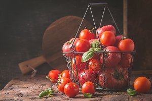 fresh tomatoes in a metal basket