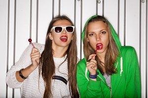 naughty girls sucking lollipops