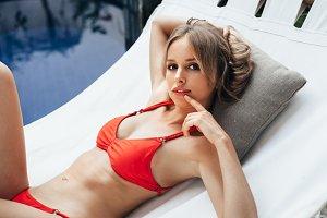 Woman laying down on white hammock