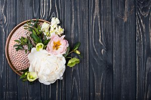 peony flowers arrangement on old wooden board background. Festiv