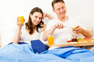 Couple Having Breakfast In Bed