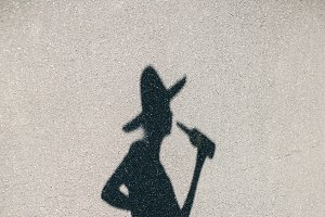 Shadow of young woman in hat