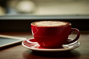 Red cup of cappuccino