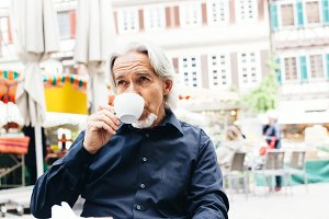 Senior Man Enjoying A Cup Of Coffee, Tuebingen, Germany