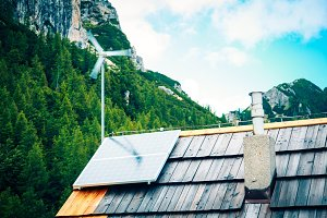 Wind Turbine And Solar Panel On Mountain Hut