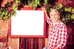 Winemaker With Billboard