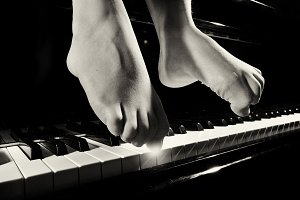 Playing piano Feet