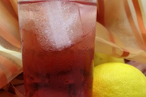 Iced glass with soda near lemons
