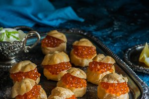 Profiteroles stuffed with red caviar