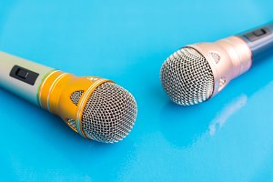 microphone on blue wooden table