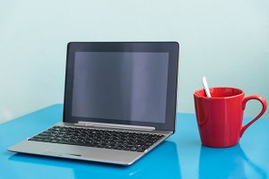 laptop and red coffee cup
