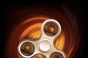 Fidget spinner in spin fire isolated on black background.