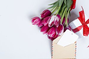 Bouquet of pink tulips with card