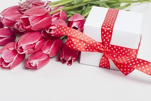 Bouquet of pink tulips znd gift box