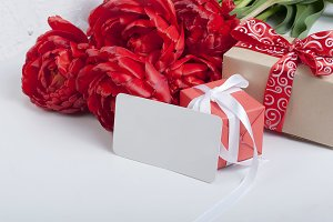 Bouquet of red tulips with gift box