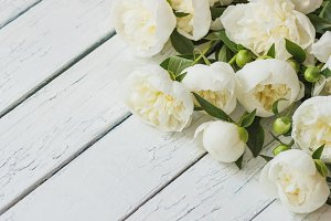 Bouquet of white peonies on the wooden table, soft focus background