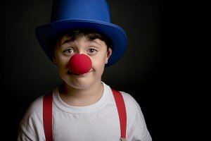 Child with clown nose