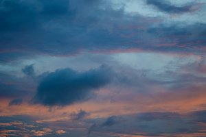Sunset sky background with clouds