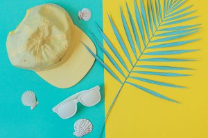 cap, sunglasses and seashells
