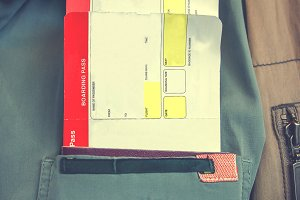 Boarding passes in pocket of shirt