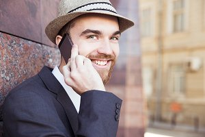 Handsome man talking on phone