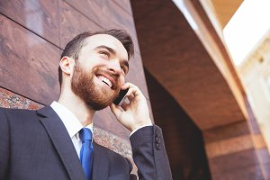 Smiling business man with phone