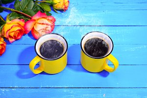 Two yellow cups of coffee