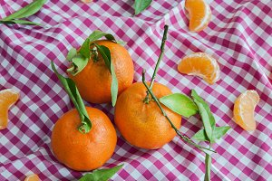 Ripe sweet tangerine with leaves