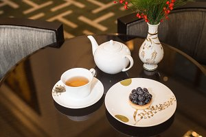 Tea and dessert on table in cafe