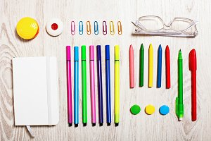 Office tools assortment on white
