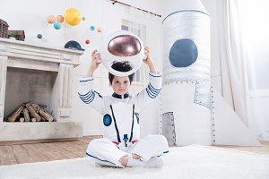 boy holding helmet