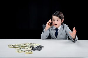 shocked boy playing businessman
