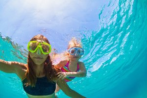 Mother and child snorkelling in sea