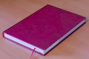 Hardcover book of a brown color