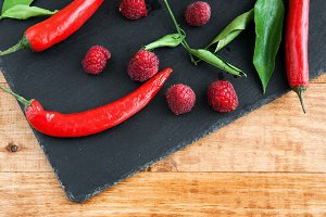 Spicy red chillies and raspberries
