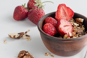 Granola with strawberry, honey, nuts