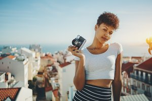 Brazilian girl with retro camera