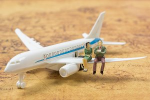 couple miniature people on a plane