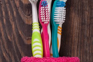 toothbrushes on the black wooden background