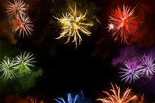 fireworks exploding over a night sky