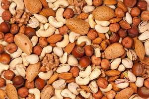Mix of different nuts as background close-up