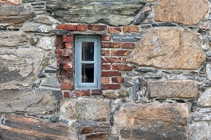 Narrow window in a stone wall