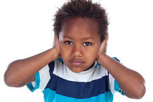 Sad african child covering his ears