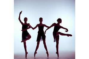 Composition from silhouettes of three young ballet dancers