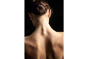 Beautiful woman, back view on dack background