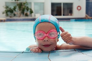 Child swimmer in the pool