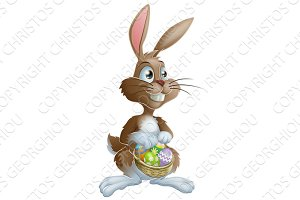 Easter bunny rabbit holding Easter eggs basket