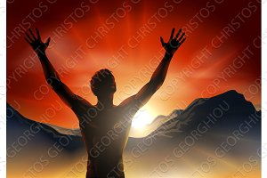 Man in silhouette arms raised on mountain