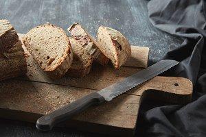 Sliced bread on wooden board