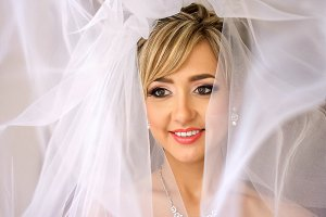 Bride's hazel eyes shine